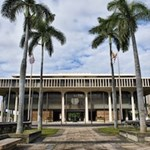 The Hawaii State Capitol building was built to represent the trademarks of Hawaii: palm trees, volcanoes, the Pacific Ocean.